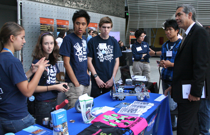 David McBride, director of NASA's Dryden Flight Research Center, visits with members of the robotics team from Beckman High School of Irvine, Calif., at the NASA SpaceFest at the California Science Center in Los Angeles.
