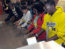 Blind students had tactile experiences in Goddard's machine shop, fabrication and assembly area.