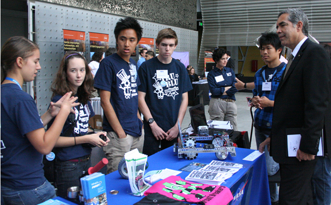 Dryden Director David McBride visits with members of the robotics team from Beckman High School of Irvine, Calif.