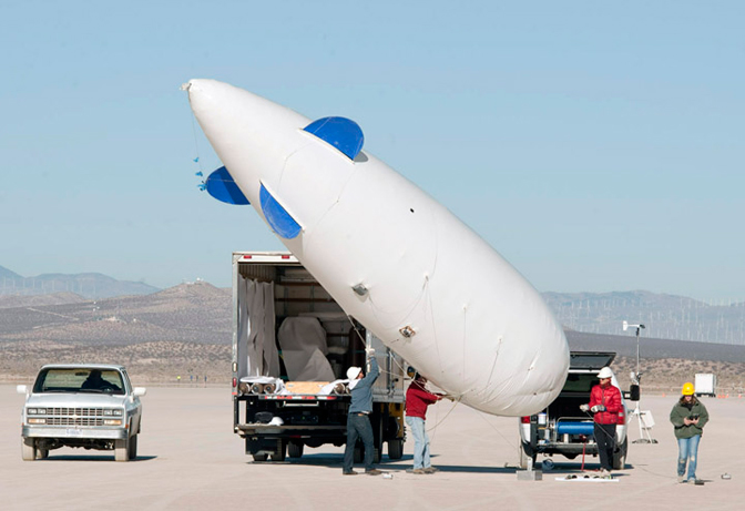 Cessna researchers prepare to launch a blimp that carries several microphones used to record sonic booms for the FaINT project.