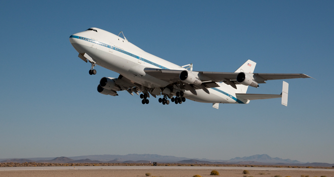 NASA's historic Space Shuttle Carrier Aircraft (SCA) No. 905 points its nose skyward after takeoff from Runway 22L at Edwards Air Force Base Oct. 24 on what is anticipated to be its final flight.