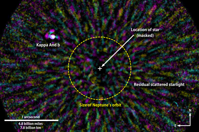This false-color near-infrared image has been processed to remove most of the scattered light from the star Kappa Andromedae (masked out at center).