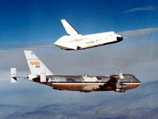 NASA 905's first mission as a Shuttle Carrier Aircraft was to serve as the launch platform for the space shuttle prototype Enterprise during the Approach and Landing Tests based at NASA Dryden on Edwards Air Force Base in 1977