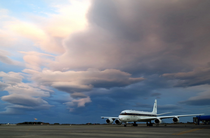 The DC-8 is pictured on the ramp in Punta Arenas, Chile, during the IceBridge mission as a storm brews in the skies above.