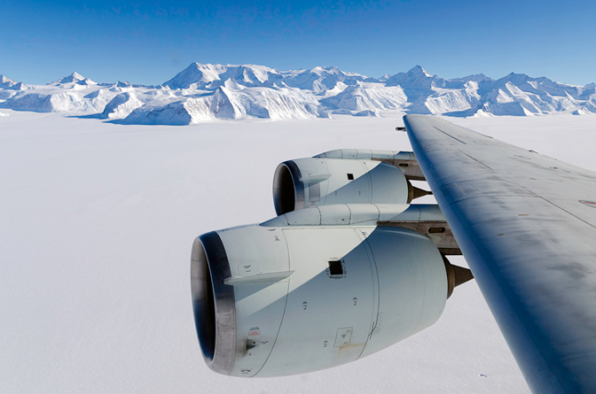 As the DC-8 Flying Laboratory passes over Ellsworth Range, Antarctica, Mount Vinson is seen in the center of the picture's background. The mountain rises to an altitude of more than 16,000 feet, making it the highest point on Antarctica.
