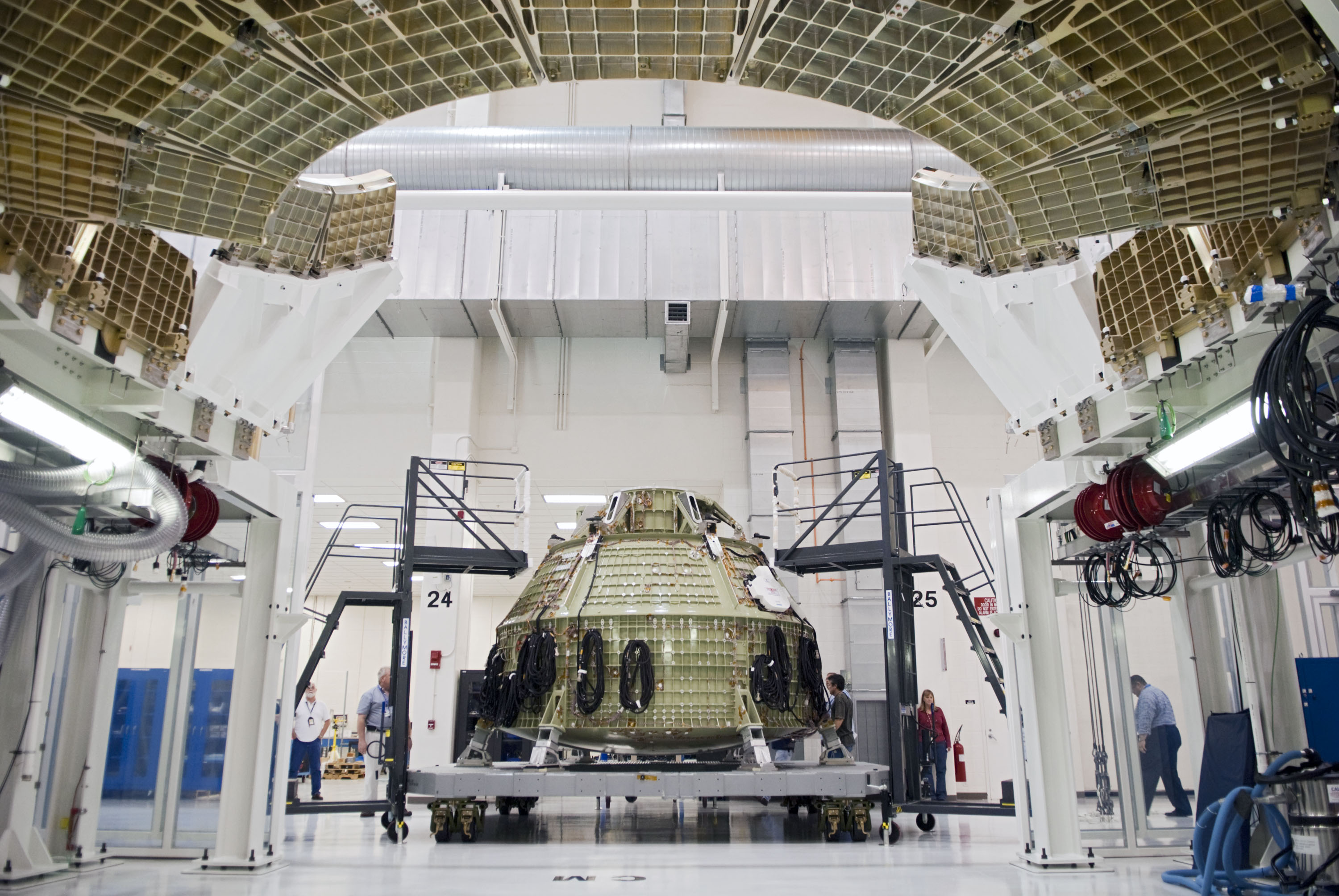 Orion spacecraft inside the operations checkout building for Nasa architecture