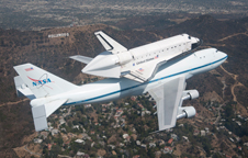 NASA Shuttle Carrier Aircraft 905 carries space shuttle Endeavour over the Hollywood Hills during the last leg of its final ferry flight into history, delivering it to the California Science Center in Los Angeles on Sept. 21, 2012.