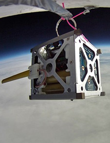 PhoneSat 1.0 hanging from a high-altitude balloon.