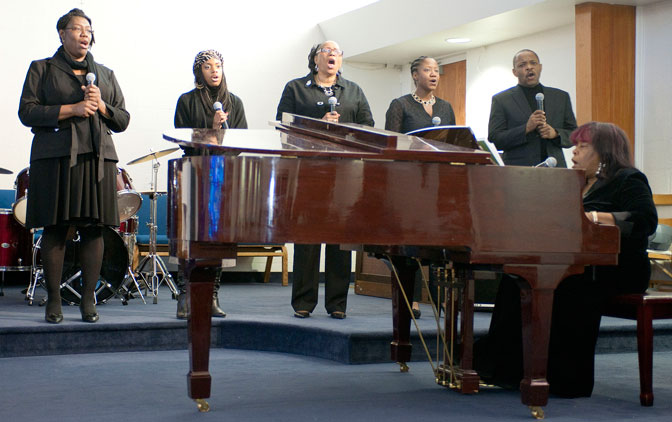 The Edwards Gospel Choir led by accompanist Linda Bowling at the piano musically honored the spiritual heritage of Martin Luther King Jr. and the civil rights movement.