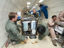 Researchers in microgravity. Some of them are floating.