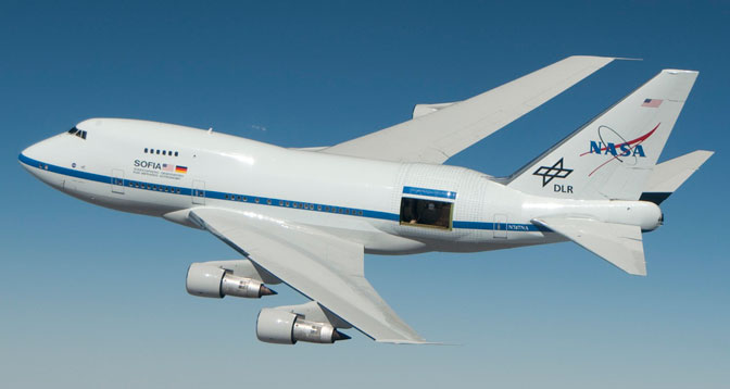 NASA's Stratospheric Observatory for Infrared Astronomy (SOFIA) is shown with its telescope door partly open during a test flight for its astronomical observation mission.