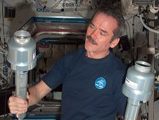 Canadian Space Agency astronaut Chris Hadfield holds two Material Science Laboratory Solidification and Quench Furnace (MSL SQF) Sample Cartridge Mechanical Protection Containers (MPCs) during the cartridge exchange in the Destiny laboratory of the International Space Station. (NASA)