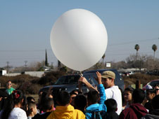 Students from Huron Middle School in Huron, Calif., got to visit researchers from Millersville University during the DISCOVER-AQ California 2013. Here they are helping launch a radiosonde, or weather balloon. Credit: Richard Clark/Millersville Univ.