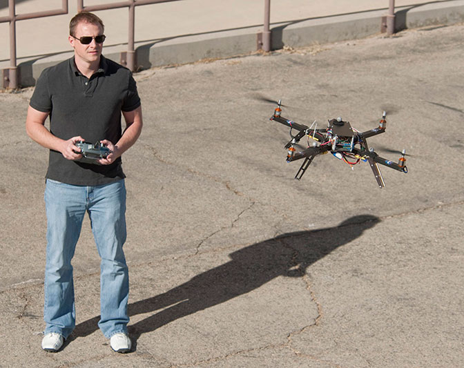 Dryden researcher Loyd Hook flies the quad rotor research vehicle to validate research on elements of a futuristic control system that has immediate applications for unmanned aircraft systems and potentially to a future personal air vehicle.