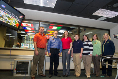 Participating in the Payload Operations Integration Center's 12th anniversary educational event are, from left, Kevin Barnes, Rick Rodriguez, Stephanie Dudley, Katie Presson, Penny Pettigrew, Carol Jacobs, and Ola Myszka.