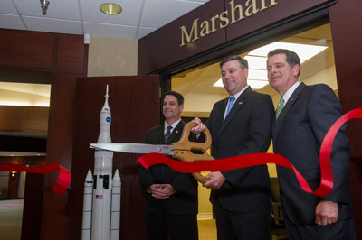 NASA's Marshall Space Flight Center Director Patrick Scheuermann, center, joined Ron Poteat, right, chairman the Chamber of Commerce of Huntsville/Madison County, and Madison Mayor Troy Trulock, left, for a ribbon cutting ceremony on March 11 for the chamber�s newly named Marshall Room.