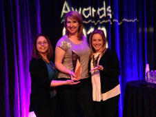 Veronica McGregor, Stephanie Smith and Courtney O'Connor accepting award