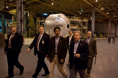 From front left, Deputy Director Robert Champion and Deputy Chief Operating Officer Malcolm Wood escort Louisiana Gov. Bobby Jindal and Louisiana District 90 Rep. Gregory Cromer through Michoud Building 103, where Lockheed Martin will manufacture cryogenic liquefied natural gas tanks.