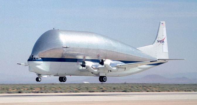 NASA's outsized SGT Super Guppy-Turbine transport aircraft lifts off the runway at Edwards Air Force Base after a prior visit.