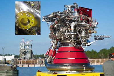 The J-2X engine before installation at the Stennis Space Center. The engine's new turbo pump exhaust port cover (detailed inset) was recently built by Pratt & Whitney Rocketdyne of Canoga Park, Calif., using a pioneering manufacturing process called Selective Laser Melting.