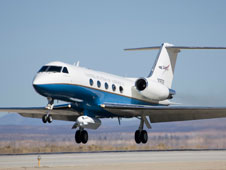 NASA's Gulfstream C-20A research aircraft lifts off the Edwards AFB runway while carrying the UAV synthetic aperture radar pod.