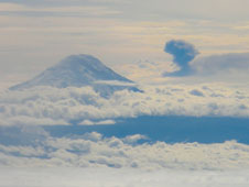 An ash cloud from an eruption of the Tungurahua volcano in Ecuador and the peak of the dormant Chimborazo volcano project through cloud cover in this photo taken from NASA's C-20A flying at 41,000 feet altitude about 100 miles northeast of Guayaquil, Ecuador on March 17.