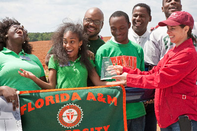 Holly Lamb, right, of ATK Aerospace Group, presents Florida A&M University of Tallahassee with the 'Closest to Altitude' award for coming closest to the specified 1-mile altitude goal. The rocket reached an altitude of 5,270 feet - just 10 feet off the mark.
