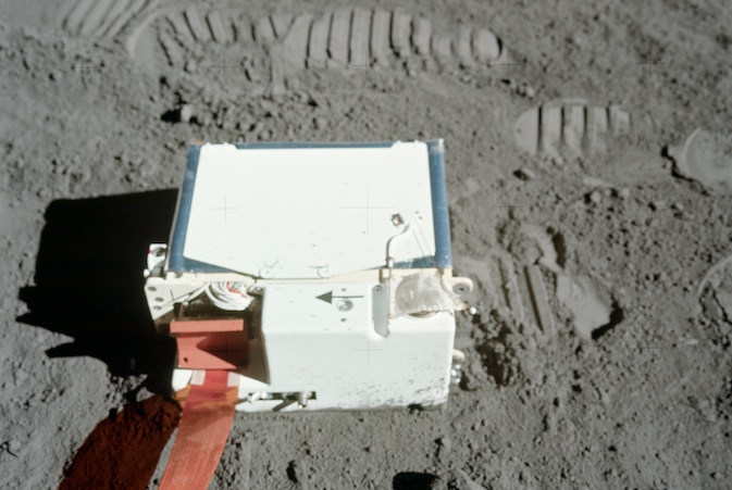 A picture of LACE on the lunar surface surrounded by astronaut footprints.