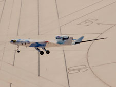 The X-48C Hybrid Wing Body research aircraft flies over the intersection of several runways adjacent to the compass rose on Rogers Dry Lake at Edwards Air Force Base during one of the sub-scale aircraft's final test flights on Feb. 28, 2013.