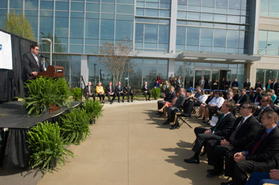 Todd May, manager of the Space Launch System Program at NASA's Marshall Space Flight Center, addresses the audience gathered at the grand opening of the first building at Redstone Gateway on April 15.