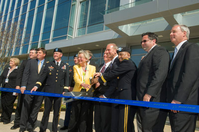 Officials from Team Redstone, including the Marshall Space Flight Center, The Boeing Co., and state and local leaders help cut the ribbon and officially open the first building of Boeing�s Redstone Gateway office complex.