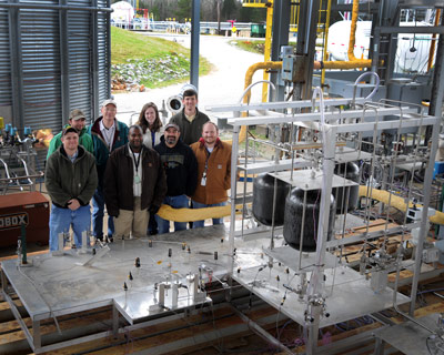 Marshall Center team members who conducted the LADEE flow testing include, back row, from left, Jeremy Briscoe, Jack Chapman, Lisa Tunstill and Hunter Williams; and front row, from left, Joey Hatchett, Cedric Evans, Craig Havens and Scott Chartier.