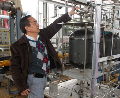 Dr. Huu Trinh examines some of the equipment used in the LADEE flow testing.