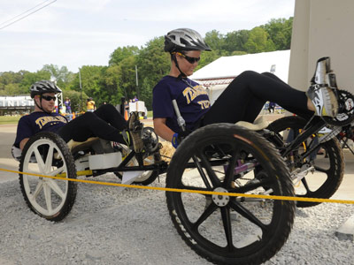 A team from Tennessee Technological University of Cookeville powers through the first course obstacle at the 2012 NASA Great Moonbuggy Race.