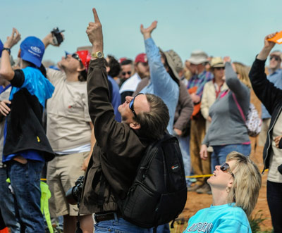 Hundreds of spectators - including Marshall Center Deputy Director Teresa Vanhooser, seated, and her husband, Mike Vanhooser, left - kept their eyes to the skies and cheered on their favorite teams at the rocketry challenge.