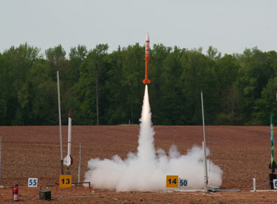 A rocket designed and built by Century College of White Bear Lake, Minn., soars off the launch pad April 21 at the 2012-13 NASA Student Launch Projects challenge. The rocket reached an altitude of 5,047 feet - a little more than 200 feet shy of the 1-mile goal.