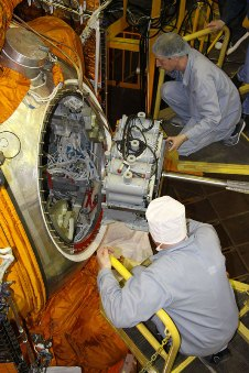 Russian technician assembles spacecraft for launch.