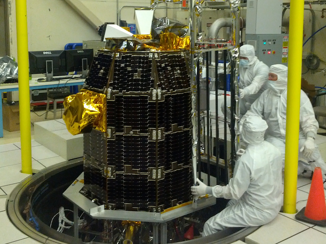 Technicians prepare the LADEE Observatory in a clean room at NASA's Ames Research Center.