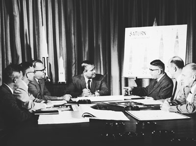 In this 1960s photo of Dr. Wernher von Braun's management team, Dieter Grau, the director of quality assurance, is the first person seated to the right of von Braun, Marshall Center's first director. The city of Huntsville recently honored Grau on his 100th birthday.