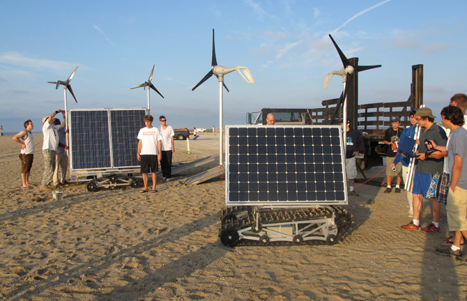 Students from a NASA Goddard summer engineering boot camp test two prototypes of GROVER at a beach in Asseteague Island, Md.,