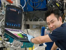 View of Japan Aerospace Exploration Agency astronaut Akihiko Hoshide, Expedition 33 flight engineer, performing a Sprint Ultrasound 2 Pre-Scan in the Columbus module on the International Space Station. (NASA)
