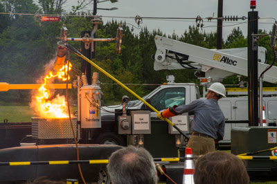 Among the Marshall Center's SHE Day programs was a fiery demonstration by Huntsville Utilities workers of the danger contained in the electrical lines that run power to our homes, and the safety procedures workers follow.