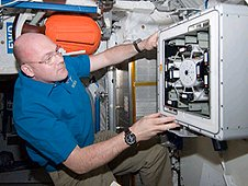 View of European Space Agency (ESA) Andre Kuipers, Expedition 30 flight engineer, working with the Kubik facility in the Columbus Module of the International Space Station. (NASA)