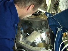 European Space Agency (ESA) astronaut Thomas Reiter works with Astrolab; one of the experiments for Astrolab was Leukin, an experiment to study how human immune system cells adapt to weightlessness. (ESA)