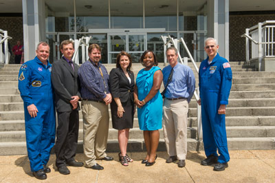 Astronauts T.J. Creamer, far left, and Lee Morin, far right, along with Marshall Deputy Director Teresa Vanhooser, honored 19 team members with Silver Snoopy awards on May 16. The honorees are, from left, Stephen E. Skelley, Hugh S. Cowart, S. Darlene Hall, Iris R. Walter, and Geoff Beech.