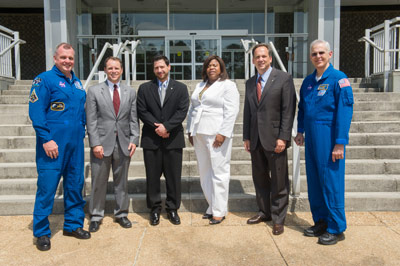 Astronauts T.J. Creamer, far left, and Lee Morin, far right, along with Marshall Deputy Director Teresa Vanhooser, honored 19 team members with Silver Snoopy awards on May 16. The honorees are, from left, Craig A. Cruzen, James E. Stott, Ayana Angela Reese, and James T. Garner.