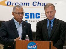NASA Administrator Charlie Bolden and Steve Lindsey, Director of Flight Operations for Sierra Nevada Corporation, respond to reporter's queries in front of Sierra Nevada's Dream Chaser test vehicle during a media briefing at NASA Dryden May 22.