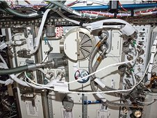 Amine Swingbed payload during installation into EXPRESS Rack 8 during Expedition 35. EXPRESS is short for Expedite the Processing of Experiments to Space Station. (NASA)