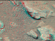 This stereo view from NASA's Mars rover Curiosity shows a rock called 'Link,' which bears rounded pebbles that provide evidence about vigorous flow of water in a stream on ancient Mars.