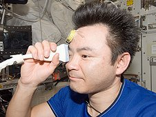 Japan Aerospace Exploration Agency astronaut Akihiko Hoshide, Expedition 33 flight engineer, performs ultrasound eye imaging in the Columbus laboratory of the International Space Station. (NASA)